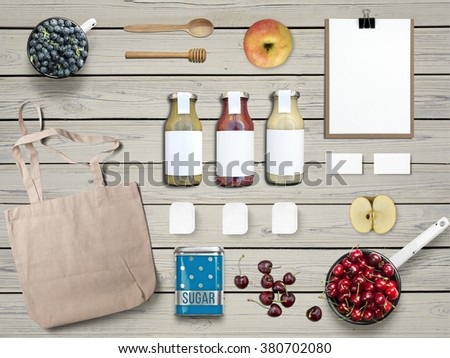 Jam branding mock up set with glass bottles and small individual portion packaging - stock photo
