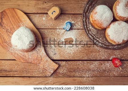Jam doughnuts with icing sugar for Hanukkah holiday celebration - stock photo