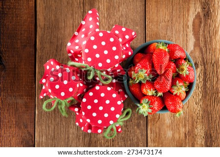 Jam from strawberries on a wooden table - stock photo