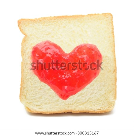 Jam heart drawn on a piece of bread.