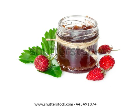 Jam made from wild strawberries in glass jar isolated on white background. - stock photo