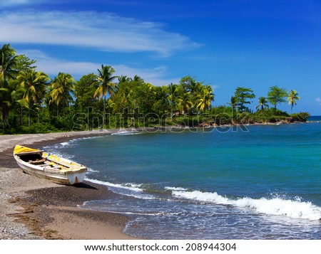 Jamaica. A national boat on sandy coast - stock photo