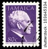 JAMAICA - CIRCA 1984: A stamp printed in Jamaica shows graphical portrait of Prime Minister Sir A. Bustamante , circa 1984. - stock photo