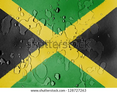 Jamaica flag  covered with water drops