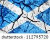 Jamaica flag on cracked earth background - stock