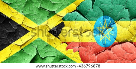Jamaica flag with Ethiopia flag on a grunge cracked wall - stock photo