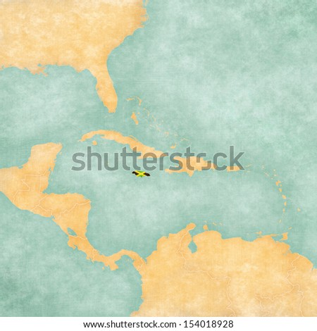 Jamaica (Jamaican flag) on the map of Caribbean and Central America. The Map is in vintage summer style and sunny mood. The map has a vintage atmosphere, which acts as a watercolor painting.  - stock photo