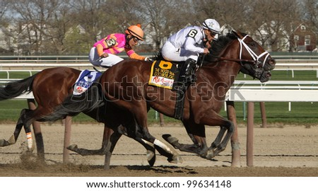 JAMAICA, NY - APRIL 7: Gemologist and Javier Castellano (#6) power down the homestretch to win The Wood Memorial at Aqueduct Race Track on April 7, 2012 in Jamaica, NY. - stock photo