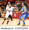 JAMAICA, NY-JAN 2: St. John's Red Storm guard Aliyyah Handford (3) dribbles around Delaware Blue Hens guard Jaquetta May (3) at Carnesecca Arena on January 2, 2013 in Jamaica, Queens, New York. - stock photo