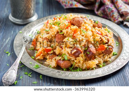 Jambalaya. Spicy rice with smoked sausage and red pepper - stock photo