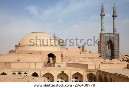 Jame Mosque and traditional bazaar among  old clay and brick buildings in ancient city of Yazd. - stock photo