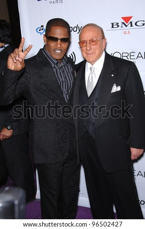 JAMIE FOXX (left) & CLIVE DAVIS at music mogul Clive Davis' annual pre-Grammy party at the Beverly Hilton Hotel. February 7, 2006  Beverly Hills, CA  2006 Paul Smith / Featureflash