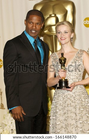 Jamie Foxx, Reese Witherspoon in the press room for OSCARS 78th Annual Academy Awards, The Kodak Theater, Los Angeles, CA, March 05, 2006 - stock photo