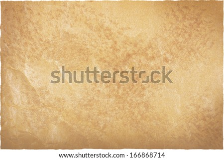 Jammed brown old worn packing paper or cardboard background with ragged edge that was became weary highlighted by sun or day light, clipping path included - stock photo