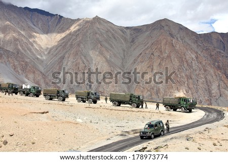 JAMMU & KASHMIR, INDIA - SEPTEMBER 04, 2011: Indian army convoy of trucks delivering supplies to remote military installations in Himalayas - stock photo