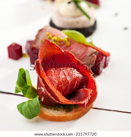 Jamon Canapes with Pesto Sauce - stock photo