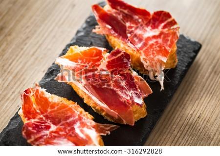 Jamon iberico, the best spanish ham tapas. - stock photo