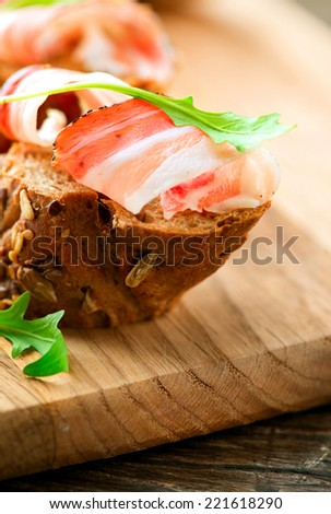 Jamon. Slices of Bread with Spanish Serrano Ham Served as Tapas. Cured ham, spanish appetizer. Prosciutto  - stock photo
