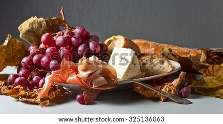 jamon with cheese , french bread and grapes