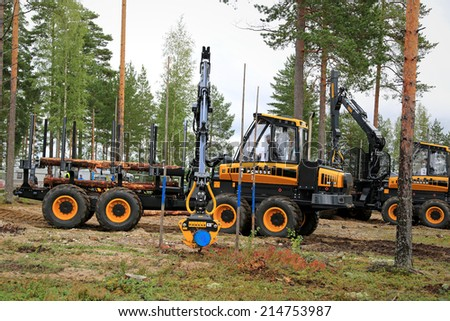 JAMSA, FINLAND - AUGUST 29, 2014: Unidentified professional takes part in the National Forest Machine Operator Competition, held at FinnMETKO 2014.