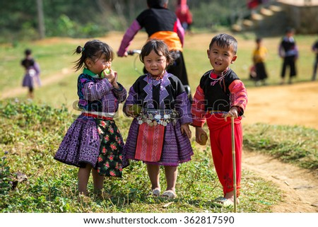 Jan 10, 2016: H'mong children in Son La, Vietnam. In time Hmong New Year at the end of the Lunar year, they often wear the most beautiful costumes, the most brilliant, from young children to adults. - stock photo