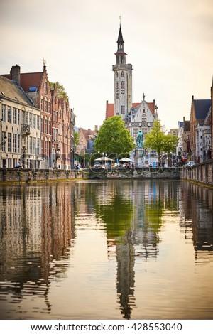 Jan van Eyckplein church in Bruges - Belgium / Famous Church at square Jan van Eyckplein / Old town of Bruges - stock photo