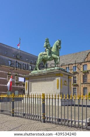 Jan Wellem Bronze Equestrian Statue at Marktplatz in front of the city hall (Altstadt) in Dusseldorf, Germany (Artist: Gabriel de Grupello (1711), design by Adolf von Vagedes (1830) - stock photo