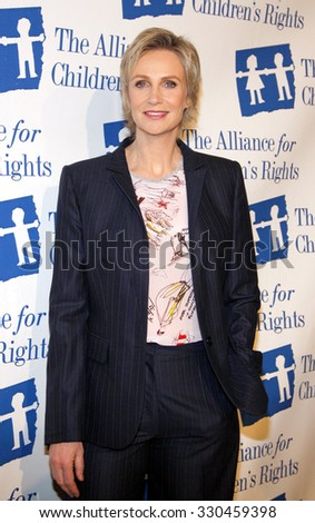 Jane Lynch at the Alliance for Children's Rights Dinner Honoring Kevin Reilly held at the Beverly Hilton Hotel in Beverly Hills, USA on March 1, 2012. - stock photo