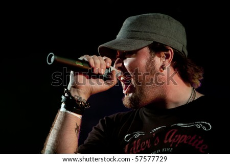 JANESVILLE, WI - JULY 16: Anchored singer Brandan Narrell performs on their 2010 U.S. tour on July 16, 2010 in Janesville, WI. - stock photo