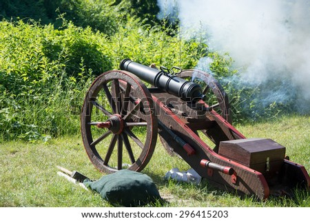 JANOWIEC, POLAND - JULY 4, 2015: old cannon in attack during the reenactment in Janowiec castle