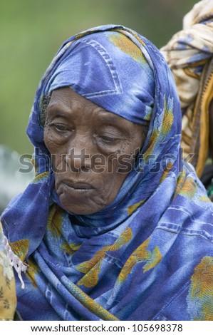 JANUARY 2007 - A Kenyan woman with a blue scarf stands in line at the Pepo La Tumaini Jangwani, HIV/AIDS Community Rehabilitation Program, Orphanage & Clinic. - stock photo