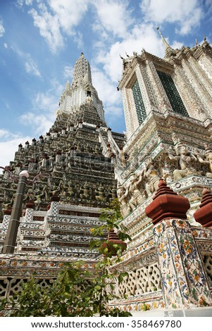 JANUARY 01, 2016 : BANGKOK - THAILAND : Traditional Thai style temple decoration of mosaic & stucco on the big pagoda in Wat Arunratchawararam temple.