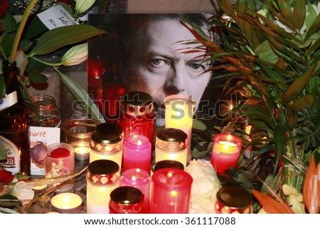 JANUARY 11, 2016 - BERLIN: candles, flowers, images - mourning for the deceased pop star David Bowie in front of the house in the Hauptstrasse in Berlin-Schoeneberg in which he lived in the 1970s. - stock photo