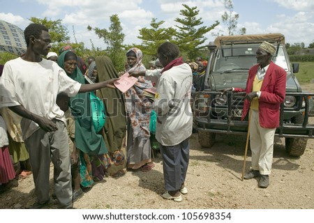 JANUARY 2007 - Brochures about HIV/AIDS are handed out at Pepo La Tumaini Jangwani, HIV/AIDS Community Rehabilitation Program, Orphanage & Clinic.  Nairobi, Kenya, Africa - stock photo