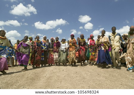 JANUARY 2007 - Grandmothers, who are the caretakers of their children and grandchildren who are infected with HIV/AIDS, dance at Pepo La Tumaini Jangwani, Nairobi, Kenya, Africa. - stock photo