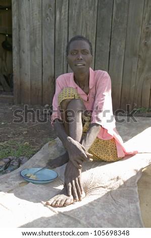 """JANUARY 2007 - """"Irene"""", infected with HIV/AIDS, sits on ground at the Pepo La Tumaini Jangwani, HIV/AIDS Community Rehabilitation Program, Orphanage & Clinic. Nairobi, Kenya, Africa - stock photo"""