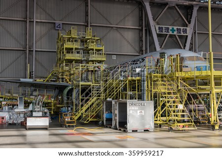 JAPAN AIRLINE FACTORY - HANEDA AIRPORT - TOKYO -JAPAN - MAR 2015: JAL Airplane in Formwork being checked in JAL Hangar on 2 March 2015