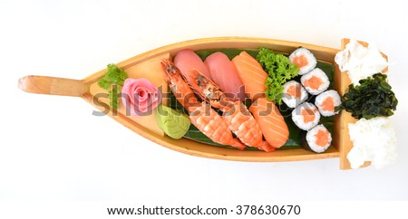 Japan assorted seafood sushi on boat - stock photo