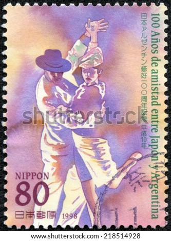 JAPAN - CIRCA 1998: A stamp printed in Japan commemorating 100 years of friendship between Argentina and Japan, shows a couple dancing tango, circa 1998 - stock photo