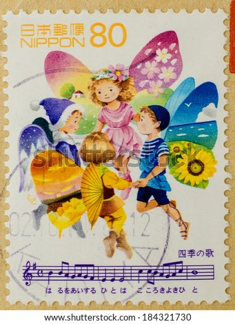JAPAN - CIRCA 1998: A stamp printed in Japan shows red headed fairy children representing the four seasons, singing the Song of Seasons, circa 1998.  - stock photo