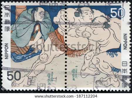 JAPAN - CIRCA 2000: A stamp printed in japan shows Sumo, circa 2000 - stock photo