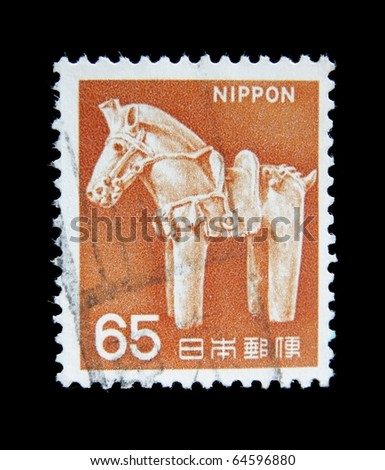 JAPAN - CIRCA 1970s: A post stamp printed in Japan shows miniature sculpture of horse,netsuke. circa 1970s.