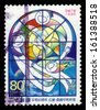 JAPAN - CIRCA 1995: stamp printed by Japan shows children holding hands behind stained glass window, peace dove, earth from space, circa 1995 - stock photo