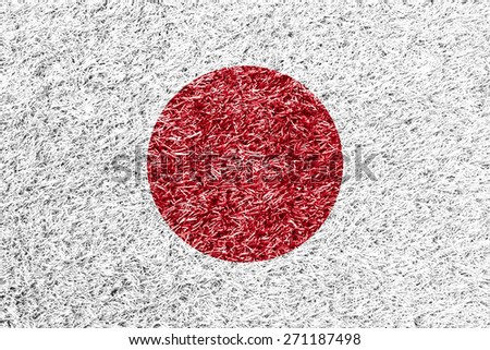 Japan flag on grass background texture - stock photo