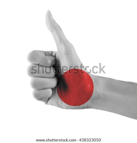 Japan flag painted hand showing thumbs up sign on isolated white background with clipping path - stock photo