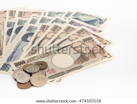 japan money, banknotes and coins on white background, selective focus