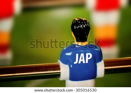 Japan National Jersey on Vintage Foosball, Table Soccer or Football Kicker Game, Selective Focus, Retro Tone Effect - stock photo