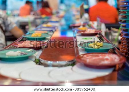 Japan restaurant sushi conveyor or belt buffet - stock photo