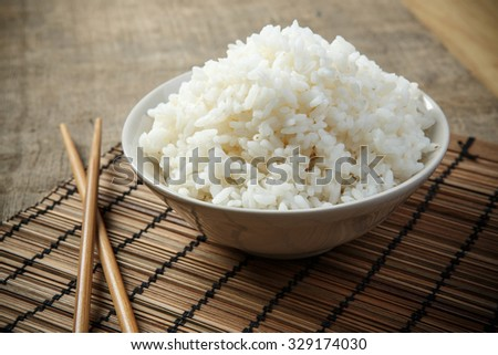 Japan rice with chopsticks on a bamboo mat - stock photo