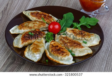 Japan traditional cuisine - fried Gyoza with sweet sauce